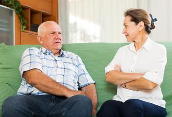 Casual mature couple having serious talking