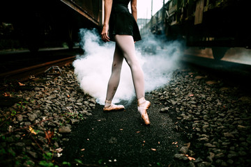 Woman Dancing Ballet in a Railtrack