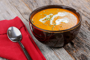 Bowl of tomato soup with chives and cream