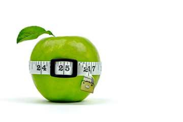 A green apple wearing a measuring tape belt.