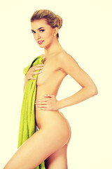 Beautiful happy woman after bath or spa, holding towel