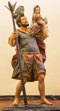 Seville - The statue of st. Christopher in baroque Church of El Salvador