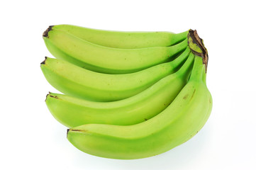green bananas on white background