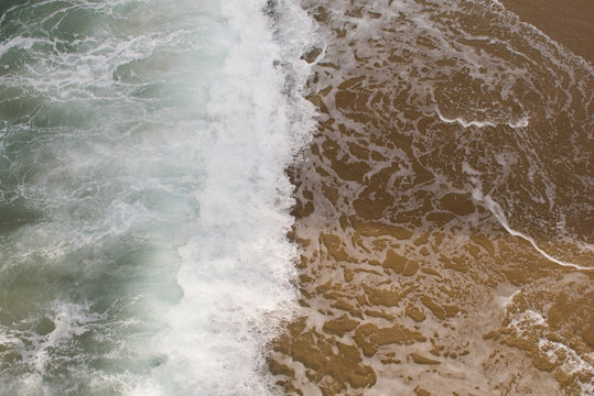 Breaking wave on the shoreline from above in Hermosa beach, California