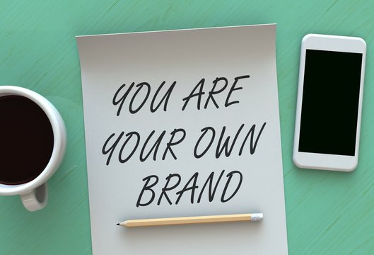 You Are Your Own Brand, message on paper, smart phone and coffee on table