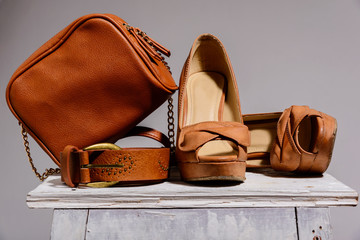 brown female bag with shoes  and belt