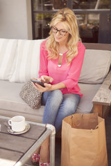Young attractive long hair woman using smartphone