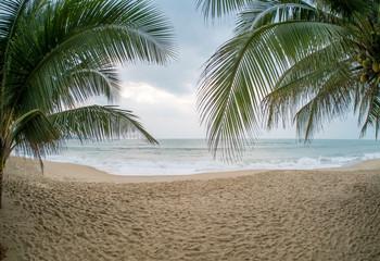 Gloomy weather on the tropical beach.