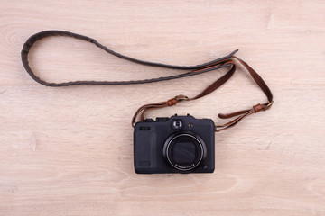 Digital camera on wooden background