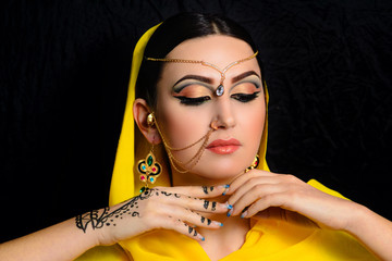 girl with bright makeup in Indian saris