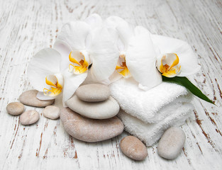 Acrylic Prints White orchids with massage stones