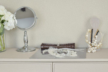 mirror,jewelry and makeup set on a table