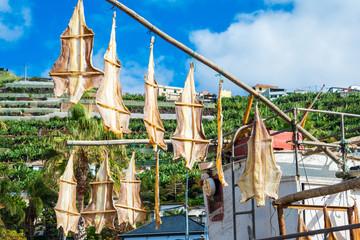 Stock fish skin hanging in Camara de Lobos, Madeira (Portugal)
