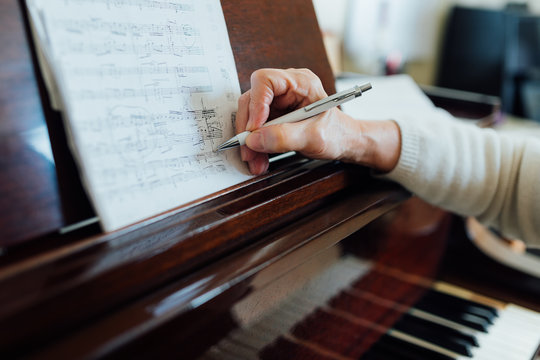 Writing notes in between the lines on  sheet music