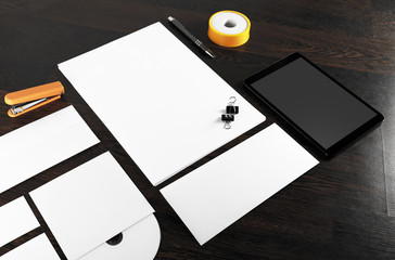 Blank corporate identity template on dark wooden background. Blank stationery. For design presentations and portfolios. ID template.