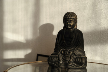 Buddha statuette on the table.