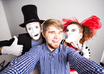 Man and Funny couple of mimes taking a selfie photo