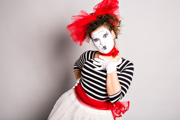 A woman clown mime posing in studio, april fools day concept