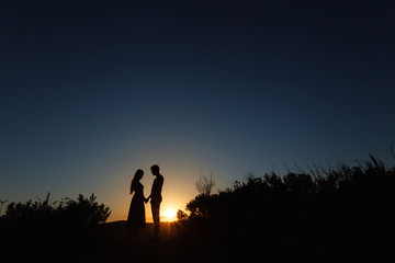 lovers at sunset are facing each other. Love. Relations. Tenderness