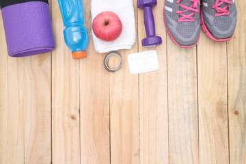 Wall Mural - Sport equipment.  water, towel, earphones and phone on wooden background