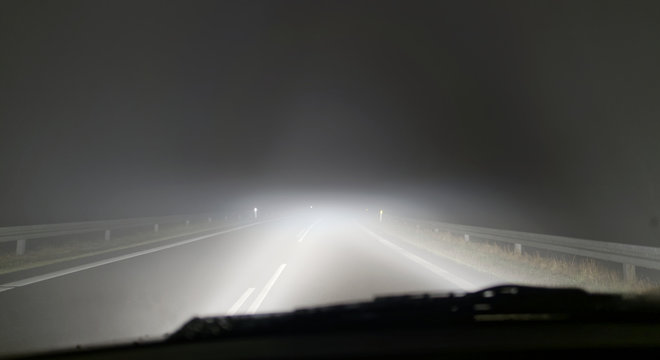 First person view of driving in heavy fog at night