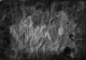 Black watercolor crumpled grunge background. Paper texture