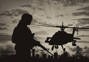 Silhouette of a terrorist and a helicopter