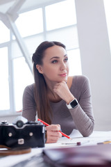 Beautiful female photo artist is creating new picture