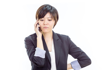 Annoyed Asian businesswoman on cell phone