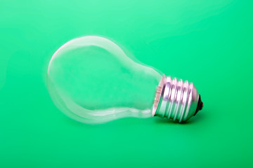 The lightbulb on a green background
