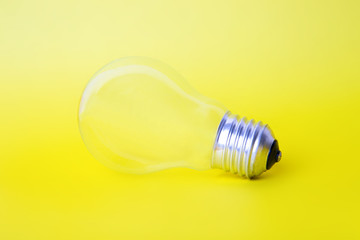 The lightbulb on a yellow background