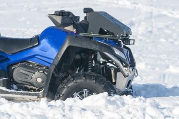 Квадроцикл в снегу