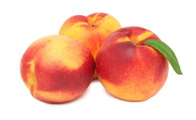 Three whole ripe nectarines (isolated)