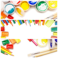 composition of multicolored drawing instruments over white background