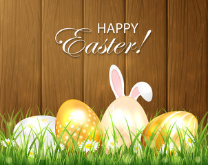 Wooden background with Easter eggs and rabbit