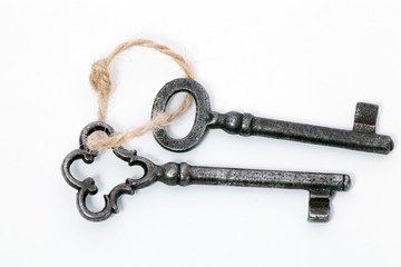 Vintage keys on a rope, isolated on white background