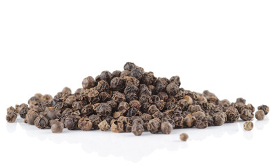 Heap or black pepper isolated on white