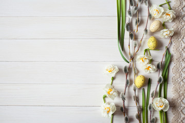 Easter light wood background with willow twigs, eggs