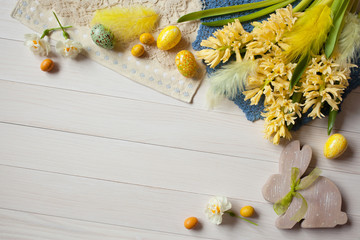 Easter background with flowers and eggs