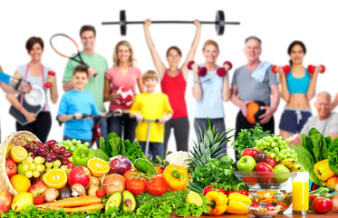 Fototapete - Group of fitness people with food.