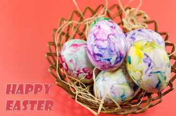 Happy Easter card with bowl of painted eggs