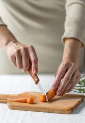 Man cutting carrots