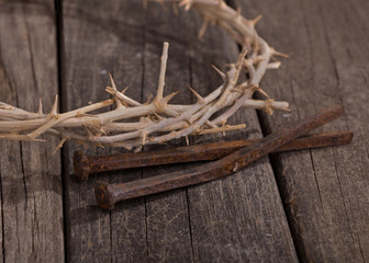 Crown of Thorns and Nails Closeup on a Rustic Wooden Surface