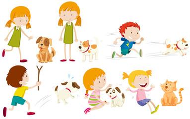 Girl and boy playing with dog