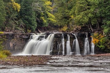 Manabezho Falls, a waterfall on the Presque Isle River, spills over a cliff at Porcupine Mountains State Park in Michigan's western Upper Peninsula.