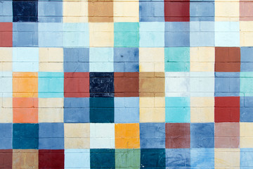 Color DSLR abstract stock image of multi-colored squares painted on cinder blocks