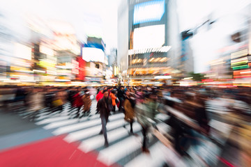 Evening rush hour at the famous Shibuya Crossing in Tokyo, Japan. This area is known as one of the fashion centers of Japan.