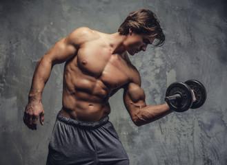 Shirtless muscular man doing biceps workout. Wall mural