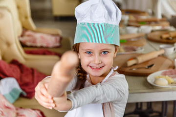 baby girl, a master class in cooking pizza , little chef in a restaurant