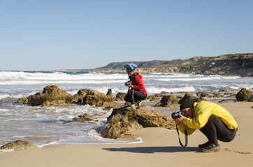 Two photographers taking pictures of the great wave. Mediterranean Sea, Cyprus